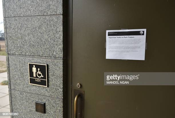 A notice about the government shutdown is seen on the door of the men's bathroom at the Martin Luther King Jr Memorial on the first full week of the...