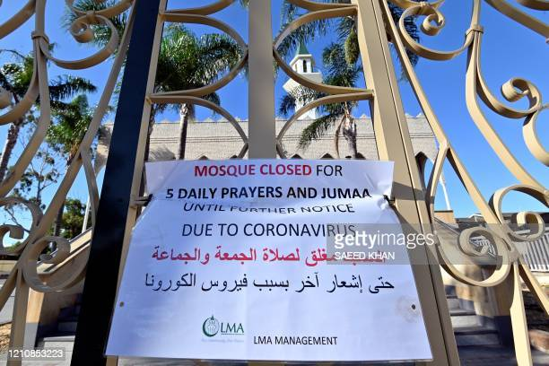 A notice advices the Lakemba mosque closer due to coronavirus hang on a fence on the first day of the holy month of Ramadan in Sydney on April 24...