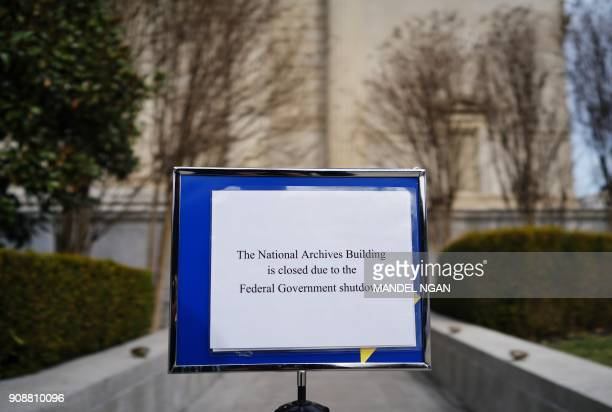 A notice alerting visitors that the building is closed is seen outside of the National Archives on the first full week of the government shutdown in...