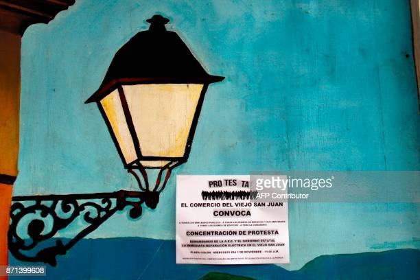A notice asking local business owners to protest against the Puerto Rico Power Authority because of the lack of power is seen pasted on a wall in Old...