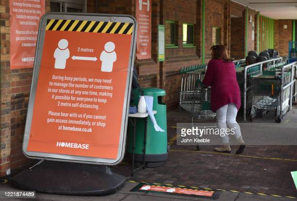 Notice board at the entrance reminding customers of the 2 metres social distancing at the Homebase store in Rayleigh Weir on April 29, 2020 in...