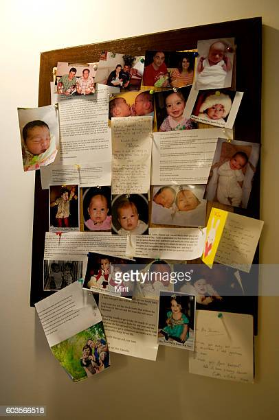 A notice board which displays letters and photographs sent by various parents to the clinic as thanks at the IVF clinic at Greater Kailash on March...