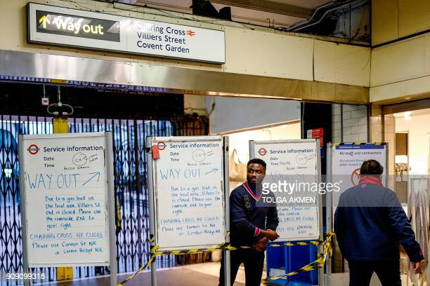 Notice boards are set up at Embankment tube station advising passengers of a gas leak closing the Strand and Charing Cross railway station in central...