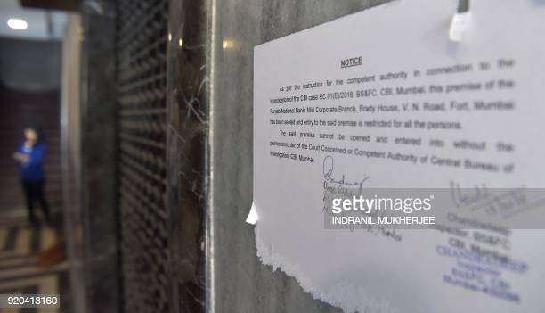 A notice by the Indian Central Bureau of Investigation stating that the Brady House branch of the Punjab National Bank has been sealed is pasted on a...
