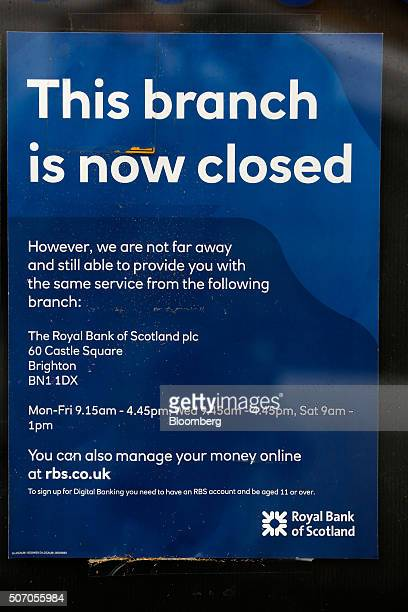 A notice hangs inside the door of a closed Royal Bank of Scotland Group Plc bank branch in Hove near Brighton UK on Wednesday Jan 27 2016 RBS said it...