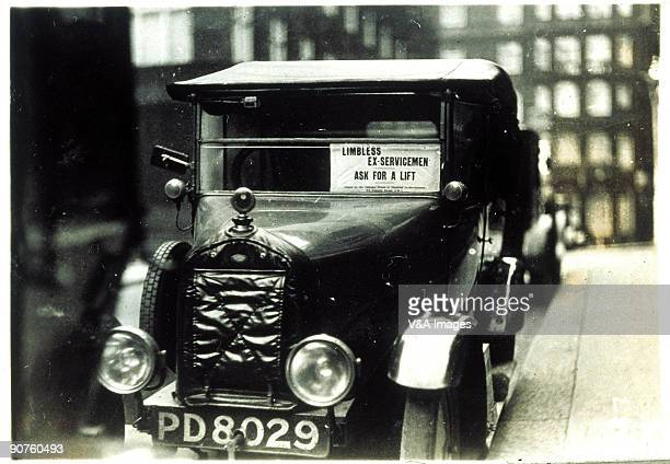 Notice in a car windscreen 'Limbless exservicemen ask for a lift' Photograph from an album compiled at the time of the General Strike in 1926