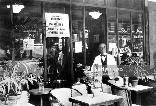 Notice in a restaurant window banning Jews from entering Germanoccupied Paris July 1940 Life for French Jews became increasingly oppressive under...