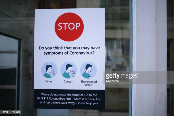 A notice instructs people with symptoms of the covid19 coronavirus not to enter St Mary's Hospital in London England on March 11 2020 The hospital...