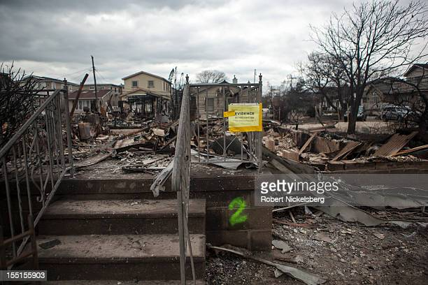 Notice is placed by an insurance company for the owner of a burned home in Breezy Point November 1, 2012 after Superstorm Sandy left millions without...