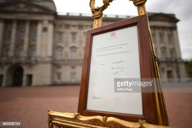 A notice is placed on an easel in the forecourt of Buckingham Palace in London to formally announce the birth of a baby boy to the Duke and Duchess...