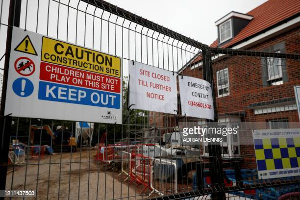 """Notice on gates leading to housing development under construction, reads """"Site Closed Till Further Notice"""" likely due to the COVID-19 pandemic, in..."""