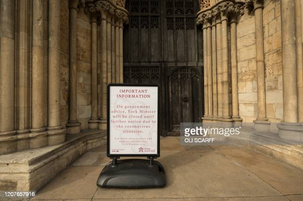 A notice outside York Minster informs members of the public that it has been closed in light of the coronavirus pandemic in the centre of York...