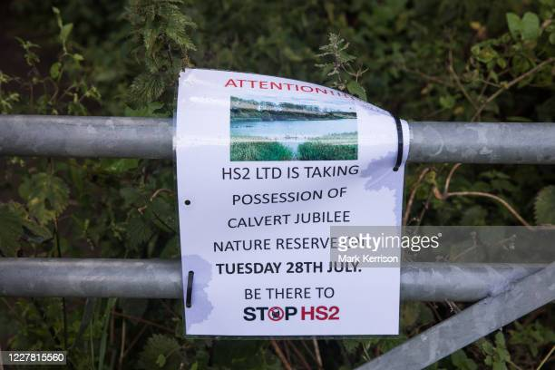 Notice posted by environmental activists from Stop HS2 is seen at Calvert Jubilee Nature Reserve on 27 July 2020 in Calvert, United Kingdom. On 22nd...