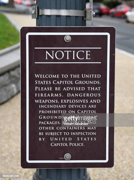 A notice posted on Capitol Hill near the Rayburn House Office Building in Washington DC advises visitors that firearms and other dangerous items are...