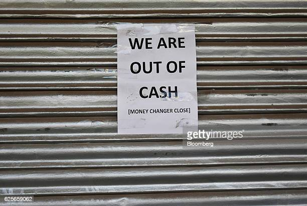 A notice reading 'We Are Out Of Cash' is displayed on the shuttered entrance of a currency exchange store in Delhi India on Friday Nov 25 2016...