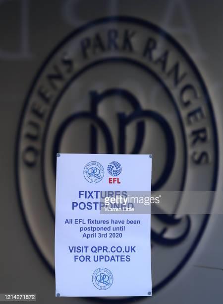 Notice regarding fixture postponement is pictured outside Loftus Road Stadium, home to Queens Park Rangers on March 23, 2020 in London, . Coronavirus...