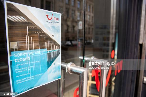 Notice telling customers that they are closed is seen on the door of a branch of the travel firm TUI in Berlin on May 13, 2020 amid the Covid-19...