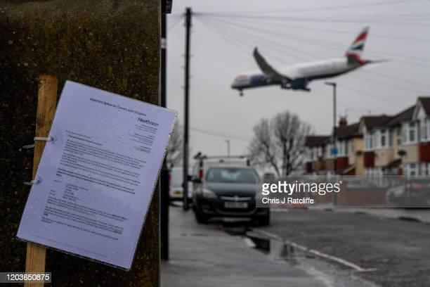 Notice to residents informing them of proposed airport plans is seen as aircraft come in to land at Heathrow airport over nearby houses on February...
