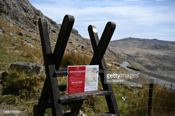 """Notice warning hikers of """"No Access"""" is pictured near Mount Snowdon, at Pen-y-Pass, in north Wales on April 5, 2020 as the warm weather tests the..."""