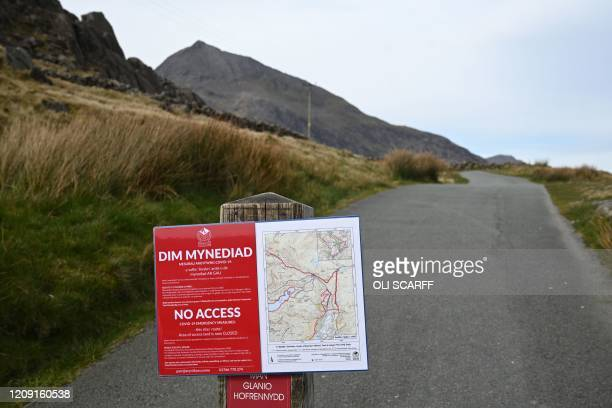 """Notice warning hikers of """"No Access"""" is pictured on the main ascent route to Mount Snowdon, at Pen-y-Pass, in north Wales on April 5, 2020 as the..."""