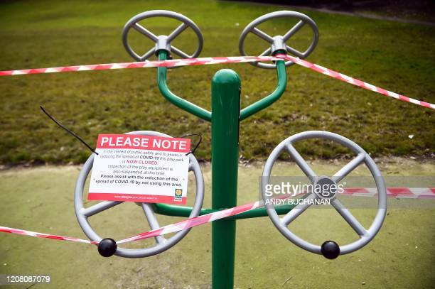 A notice warns people that the outdoor gym equipment is closedoff to the public due to the ongoing Covid19 pandemic in Queen's Park Glasgow on March...