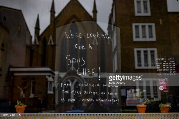 Noticeboard advertising a vacancy for a sous chef is seen in the window of the Job Centre bar and restaurant on June 04, 2021 in Deptford, South...