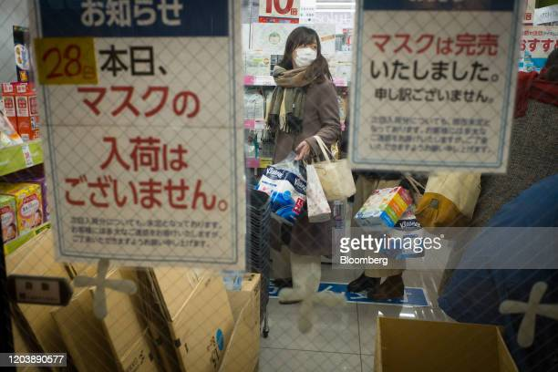 Notices indicating that protective masks are sold out are displayed in the window of a drug store in Tokyo Japan on Feb 28 2020 After a false rumor...