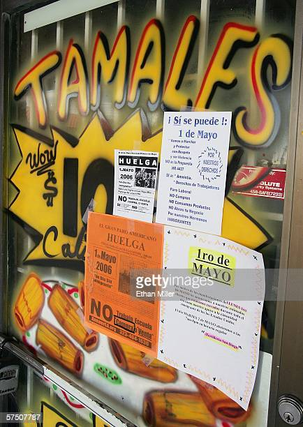 Notices posted on the front door of the Tortilleria San Diego restaurant informs customers that the business is closed as part of a Day Without...
