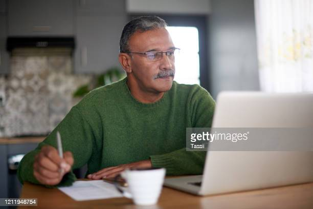 noting down the best investment options for him - life insurance stock pictures, royalty-free photos & images
