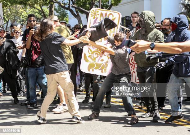 NoToMarxism rally members and counter protesters clash on August 27 2017 at Martin Luther King Park Jr Civic Center Park in Berkeley California / AFP...
