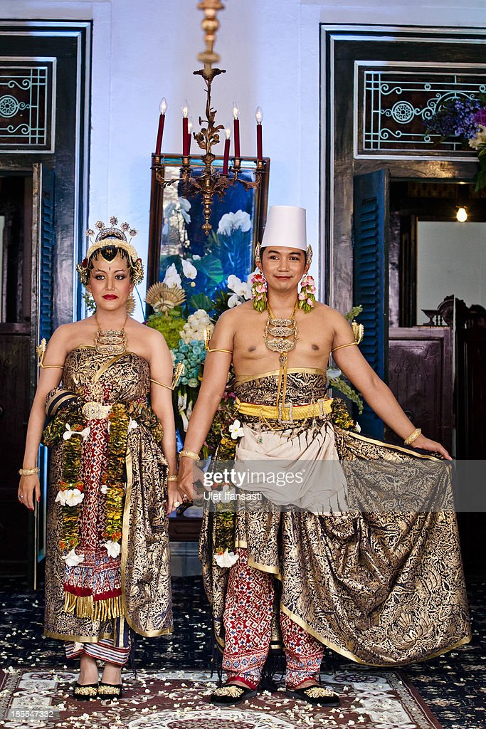 Notonegoro and Gusti Kanjeng Ratu Hayu pose for a photograph as part of their wedding procession in Bangsal Kesatriyan at Kraton Palace during the Royal Wedding Held For Sultan Hamengkubuwono X's Daughter Gusti Ratu Kanjeng Hayu And KPH Notonegoro on October 22, 2013 in Yogyakarta, Indonesia. Wedding celebrations will take place October 21-23 October. The wedding parade will include 12 royal horse drawn carriages and will be streamed live on the internet so that it can be watched by people all over the world.