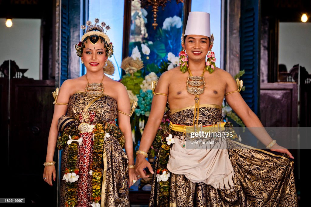 Notonegoro and Gusti Kanjeng Ratu Hayu pose for a photograph during their wedding ceremony in Bangsal Kesatriyan at Kraton Palace during the Royal Wedding Held For Sultan Hamengkubuwono X's Daughter Gusti Ratu Kanjeng Hayu And KPH Notonegoro on October 22, 2013 in Yogyakarta, Indonesia. Wedding celebrations will take place October 21-23 October. The wedding parade will include 12 royal horse drawn carriages and will be streamed live on the internet so that it can be watched by people all over the world.