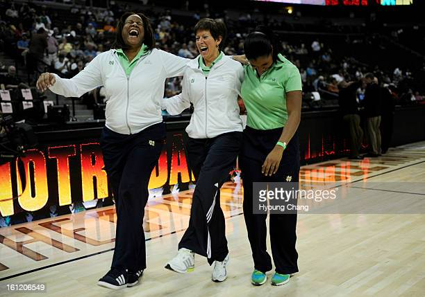 Notre Dam associate coach Carol Owens head caoch Muffet McGraw and assistant coach Niele Ivey show Irish dance to the fans after the team practice at...