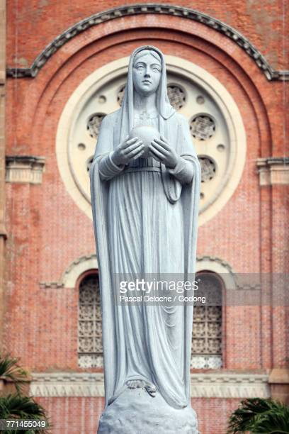 Notre Dame Cathedral and Virgin Mary statue. Ho Chi Minh City. Vietnam.