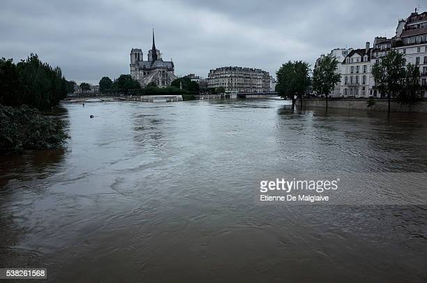 Notre Dame cathedral on the Ile de la Cite in the background as the Seine river's embankments overflow after five days of heavy rain on June 3 2016...