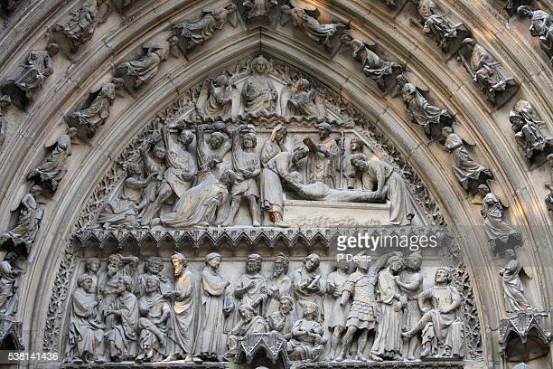 Notre Dame Cathedral. South facade. Saint-Etienne's gate tympanum. Life of Saint-Etienne