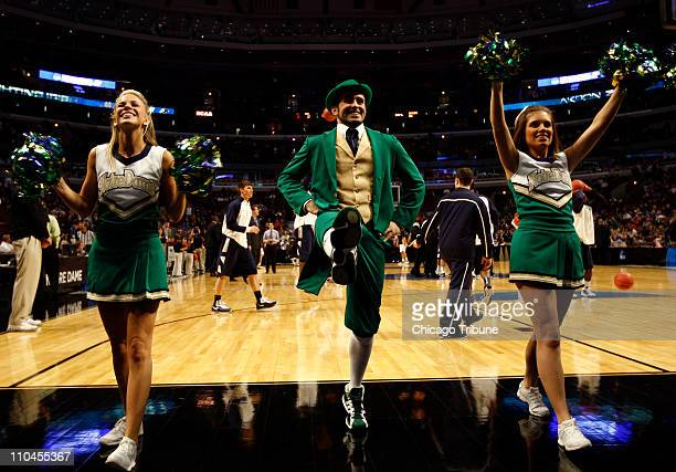 Notre Dame cheerleaders perform during a timeout in the game between Norte Dame and Akron during secondround action in the 2011 NCAA men's basketball...