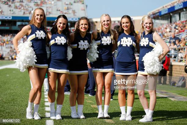 Notre Dame cheerleaders pose before a game between the Boston College Eagles and the Notre Dame Fighting Irish on September 16 at Alumni Stadium in...