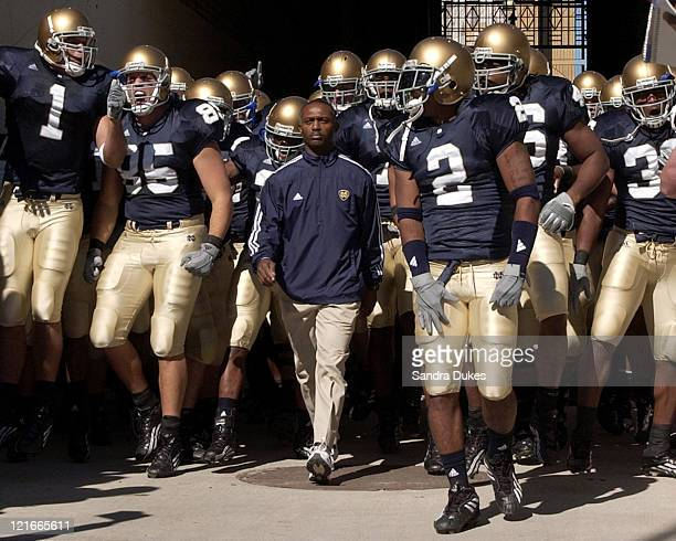 Notre Dame Coach Tyrone Willingham walks down the tunnel to the field with his team in before the game in Purdue's 41-16 win over Notre Dame in Notre...
