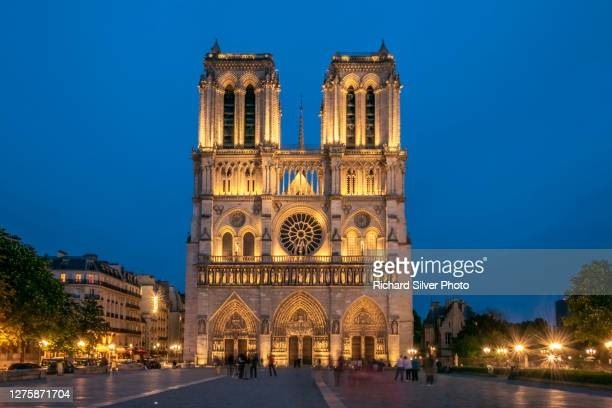 notre dame de paris at night - history stock pictures, royalty-free photos & images