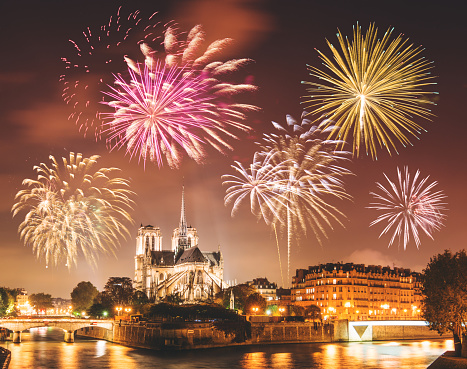 Notre Dame de paris in night with fireworks 639947784