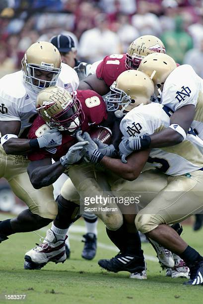 Notre Dame defenders swarm running back Greg Jones of Florida State on October 26 2002 at Doak Campbell Stadium in Tallahassee Florida Notre Dame...