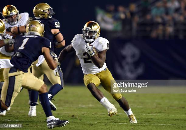 Notre Dame Dexter Williams runs the ball during a college football game between the Navy Midshipmen and the Notre Dame Fighting Irish on October 27...