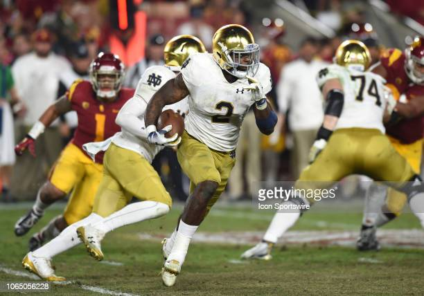 Notre Dame Dexter Williams runs the ball during a college football game between the Notre Dame Fighting Irish and the USC Trojans on November 24 at...