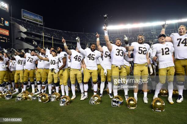 Notre Dame faces their fan section and sings their alma mater during a college football game between the Navy Midshipmen and the Notre Dame Fighting...