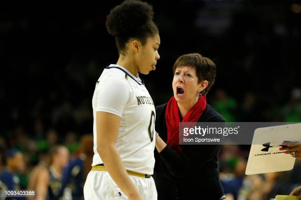 Notre Dame Fight Irish Head Coach Muffet McGraw offers some words of encouragement to Notre Dame Fight Irish guard Jordan Nixon during a break in the...