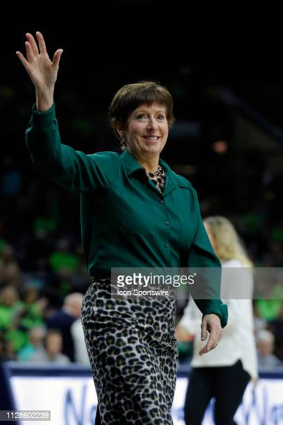 Notre Dame Fight Irish Head Coach Muffet McGraw waves to the crowd prior to the game between Virginia Cavilers and the Notre Dame Fighting Irish on...