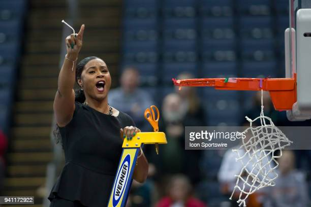 Notre Dame Fighting Irish associate coach Niele Ivey celebrates after winning the National Championship game between the Mississippi State Lady...