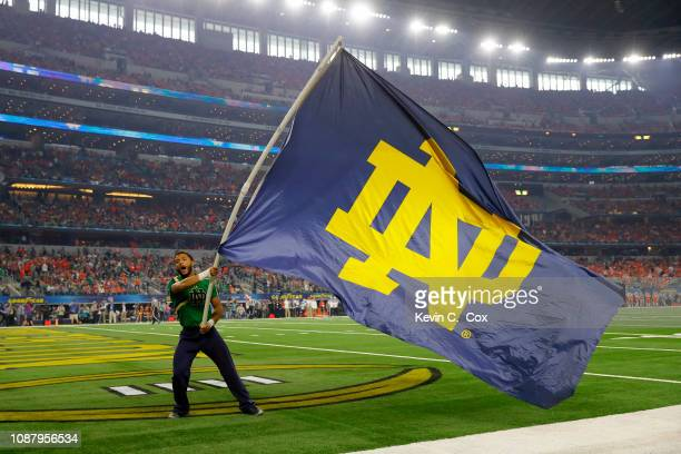 Notre Dame Fighting Irish cheerleader waves a flag during the College Football Playoff Semifinal Goodyear Cotton Bowl Classic against the Clemson...