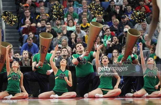 Notre Dame Fighting Irish cheerleaders cheer during the NCAA Division 1 Men's Basketball Championship game between Notre Dame Fighting Irish and West...